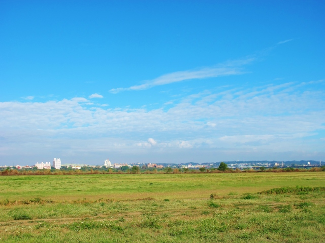 View across grassland on the east bank of the Gaoping River, on an unusually smog-free sunny day.